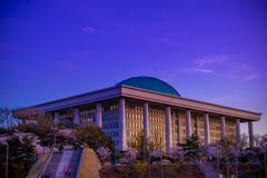 The National Assembly in Seoul. SEOUL, SOUTH KOREA - APRIL 4, 2018: The National Assembly in Seoul, South Korea in a beautiful sunset. Taken from Yeouido Han royalty free stock photos
