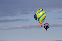 National Balloon Classic. Indianola, IA, USA - Aug. 2, 2016 - A trio of hot air balloons float above Indianola, Iowa, during the National Balloon Classic on Aug stock images
