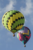 National Balloon Classic. Indianola, IA, USA - July 30, 2016: A pair of hot air balloons float above Indianola, Iowa, during the National Balloon Classic on July royalty free stock images