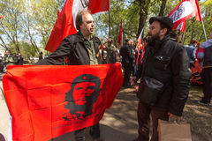 National Bolsheviks, together with Communist party supporters take part in a rally marking the May Day in the center of Moscow. MOSCOW, RUSSIA - MAY 1, 2016 royalty free stock image