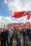 National Bolsheviks, together with Communist party supporters take part in a rally marking the May Day in the center of Moscow. MOSCOW - MAY 1, 2016: National stock image