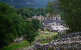 National Bulgarian flag waving over medieval Tsarevets castle stronghold in the city of Veliko Tarnovo, Bulgaria. Royalty Free Stock Photography
