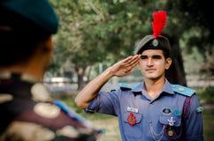 NCC cadet saluting his senior cadet stock photo