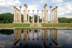 National Capitol Columns reflected. The 22 Corinthian sandstone columns known as the National Capitol Columns are a famous landmark located in the National Royalty Free Stock Image