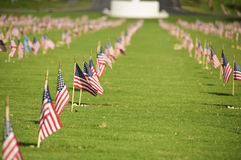 National Cemetery. A row of flags at the grave sites on Memorial Day (2011) at the Punch Bowl National Cemetery on the Island of Oahu in Hawaii Royalty Free Stock Photo