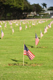 National Cemetery. A row of flags at the grave sites on Memorial Day (2011) at the Punch Bowl National Cemetery on the Island of Oahu in Hawaii Stock Photos