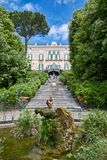 Neoclassic villa garden with fountain royalty free stock photo