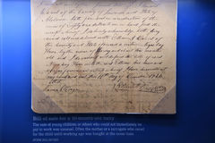 The National Civil Rights Museum in Memphis Tennessee. Memphis, TN, USA - June 9, 2017: Bill of Sale for 10 month old slave on display at the National Civil stock photos