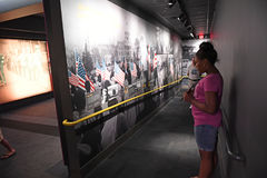The National Civil Rights Museum in Memphis Tennessee. Memphis, TN, USA - June 9, 2017: Young girl in front of exhibit at the National Civil Rights Museum and royalty free stock photo