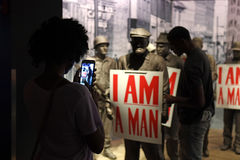 The National Civil Rights Museum in Memphis Tennessee. Memphis, TN, USA - June 9, 2017: A young woman takes cellphone photo at the I Am A Man exhibit at the royalty free stock photography
