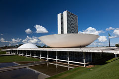 Brazil National Congress in Brasilia. The National Congress building in Brasilia during the day with the national flag in the background Royalty Free Stock Images