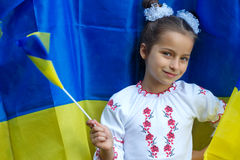 In national costume against of Ukrainian flag Stock Photo
