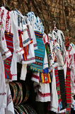 Traditional colored handmade national costumes specific from Romania. Presented at a popular art fair Stock Images