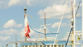 Polish flag waving on yacht. National country symbol on boat. Polish flag waving on yacht during sunny weather royalty free stock images