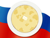 National cuisine. Russian pancakes. Russian pancakes on a plate on a national flag Stock Photos