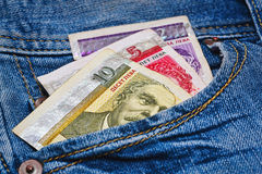 National currency of Bulgaria in jeans pocket. Some bulgarian bank notes - just around 8 euro or 10 US dollars - in worn blue classic jeans pocket - macro Stock Photography