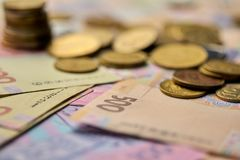 national currency of Ukraine paper and iron money close-up view of cash stock photo