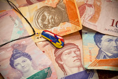 National currency of Venezuela - Bolivar. Suspension - souvenir. Painted in the colors of the flag of Venezuela Stock Photography