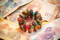 The national currency of Venezuela, Latin America. handmade bracelet Royalty Free Stock Image