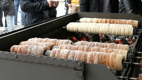 National Czech trdelnik sweet delicacy that prepared on the street.Traditional Czech and Hungarian sweet bakery trdelnik. National Czech trdelnik sweet delicacy stock video footage