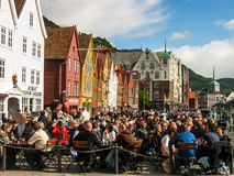 National Day of Norway. Norwegians celebrating the 17th of May, their national day, in Bryggen, the Hanseatic commercial buildings, symbol of the city of Bergen Stock Photo