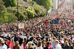 National day in Norway. Oslo, Norway, 17th May 2014: National day in Norway. Norwegians at traditional celebration and parade on Karl Johans Gate street Royalty Free Stock Photos