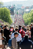 National day in Norway. Oslo, Norway, 17th May 2014: National day in Norway. Norwegians at traditional celebration and parade on Karl Johans Gate street Royalty Free Stock Image