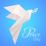 National Day of Peace. White origami pigeon with a branch of olive. Stock Images