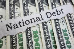 National Debt headline. National Debt news headline on cash royalty free stock photos