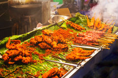 National dish popular in many other Southeast Asian countries Sa. Tay is Grilled pork with yellow curry powder stock photo