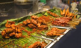 National dish popular in many other Southeast Asian countries Sa. Tay is Grilled pork with yellow curry powder royalty free stock photography