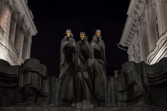 National Drama Theatre in Vilnius. Vilnius, Lithuania. Statues of Three Muses on Lithuanian National Drama Theatre at night. National Drama Theatre in Vilnius on Royalty Free Stock Photography