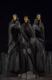 National Drama Theatre in Vilnius. Statues of Three Muses on Lithuanian National Drama Theatre at night. National Drama Theatre in Vilnius on Gediminas Avenue Royalty Free Stock Photos