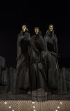 National Drama Theatre in Vilnius. Statues of Three Muses on Lithuanian National Drama Theatre at night. Three statues of Muses above entrance to Lithuanian Royalty Free Stock Photos