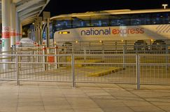 National Express coach station Stansted airport. National Express coach station at Stansted airport near London with one bus visible. Picture taken at night Royalty Free Stock Image
