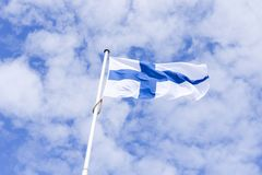 National Finnish Flag with blue cloudy sky Royalty Free Stock Image