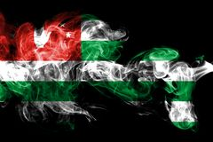 National flag of Abkhazia made from colored smoke isolated on black background. Abstract silky wave background. National flag of Abkhazia made from colored vector illustration