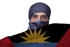 National flag Antigua and Barbuda. In the hands of an Arab man stock image