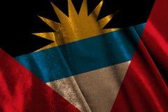 Flag Antigua and Barbuda. National flag Antigua and Barbuda on velvet fabric royalty free stock image