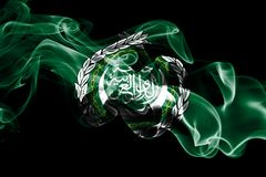 National flag of Arab League made from colored smoke isolated on black background. Abstract silky wave background.  royalty free stock photos