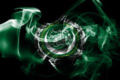 National flag of Arab League made from colored smoke isolated on black background.  stock images