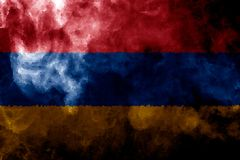 National flag of Armenia. From thick colored smoke on a black isolated background Royalty Free Stock Images
