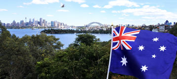 The National flag of Australia flay along Sydney skyline. Australia Stock Photo