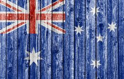 National flag of Australia on old wood background. National flag of Australia on old weathered wood background Stock Photos