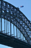 The National flag of Australia on Sydney Harbour Bridge. The National flag of Australia blows on Sydney Harbour Bridge in Sydney New South Wales,  Australia Royalty Free Stock Images