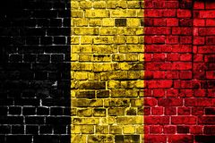 National flag of Belgium on a brick background. Concept image for Belgium: language , people and culture royalty free stock photo