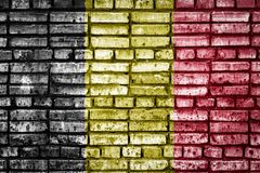 National flag on a brick background. National flag of Belgium on a brick background. Concept image for Belgium: language , people and culture stock image