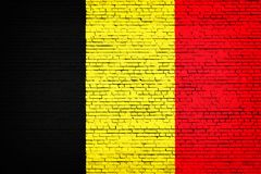 National flag of Belgium on a brick. Background royalty free stock image