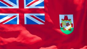 The national flag of Bermuda flutters in the wind