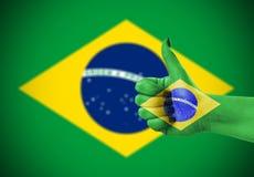 National flag of Brazil on hand Stock Photography